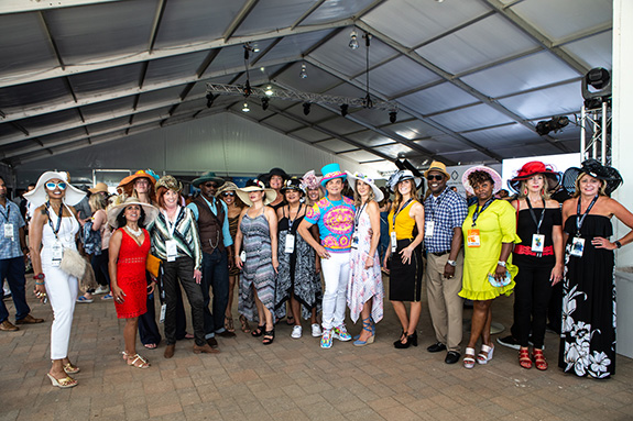 Dallas' Mad Hatter Shane Walker with the Haute Hat contestants