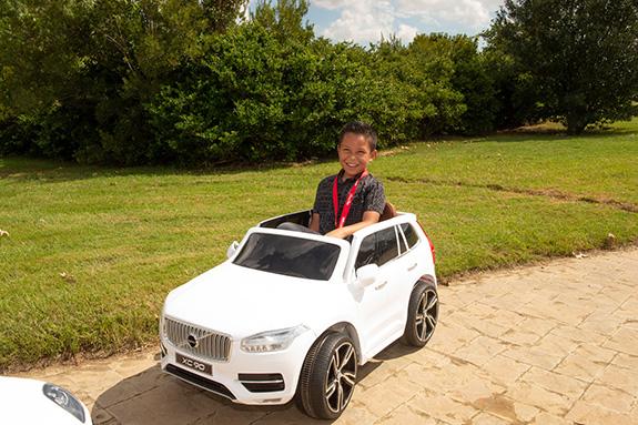 Nathan Prado drives a miniature Volvo XC90 battery-powered car