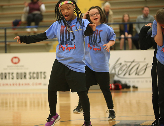 Members of the Pep Squad from the Notre Dame School perform at halftime of one of the games.