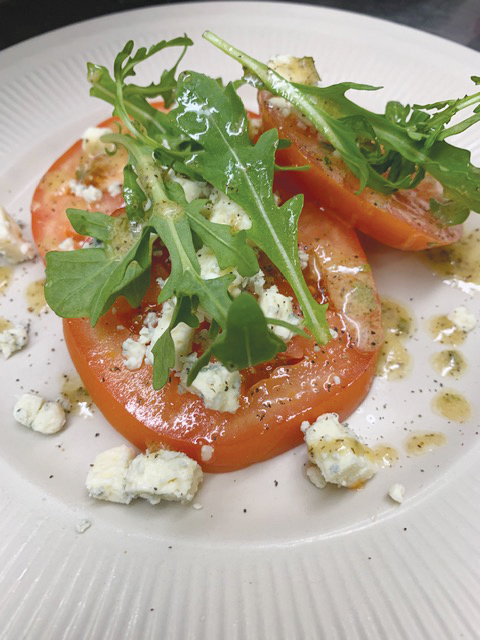 Adelmos: Tomatoes & Gorgonzola Crumbles & Arugula with Red Wine Dijon Vinaigrette